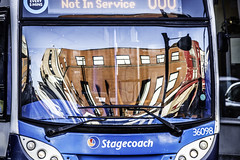 That sinking feeling (tootdood) Tags: canon70d stevenson square manchester blue sky reflection sinking feeling bus omnibus stagecoach