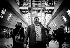 Big is Beautiful (Mister G.C.) Tags: blackandwhite bw ricoh ricohgr streetphotography urbanphotography candid street shot image photograph people monochrome town city man male guy big largeglasses spectacles close closeup station railwaystation hannoverhauptbahnhof zonefocus zonefocusing snapfocus pointshoot mistergc schwarzweiss strassenfotografie hannover niedersachsen lowersaxony deutschland europe