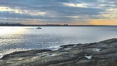 Morning Cruise (Lojones13) Tags: shorelinerockyrocks outdoor shore coast sky water bay boat pelhambay newyork d5300 morning clouds sea
