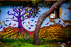 "Tree, ""tree"" and colourful birds (rodiann) Tags: rhodes rhodos rodi greece grecia grece tree colours green red birds colourful grass wall window pine outdoor art"