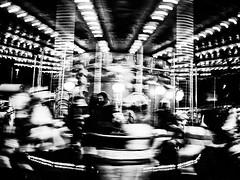 The carny (mr.reverend) Tags: carousel carny fun longexposure street streetphotography urban candid city citylife rome italy blackandwhite bw monochrome