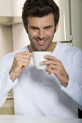 Depositphotos_4830838_original (engvnnet) Tags: beverage breakfast casual casualattire caucasian coffee cup drink drinktshirt drinking food foodanddrink holding holdinghands home house indoor kitchen lifestyle looking lookingatcamera man oneperson people portrait single smile smiling tea 3035years adult adults adultsonly aliment brunch oneman tisane