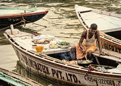 Impressions of India – 16 (Chizuka2010) Tags: uttarpradesh uttarpradeshtourism varanasi benares waterway ganges ganga gangesriver boat man cooking cookingonboat simplelife basicnecessities india inde travel travelphotography streetphotography candidphotography dailylife everydaylife luciegagnon chizuka2010 femalephotographer