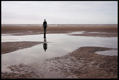 22nd of October 2016 (Paul of Congleton) Tags: october 2016 anotherplace anthonygormley crosby sefton merseyside england uk sculpture stature art beach coast sea reflection tide olympus om4ti 35mm fujichrome sensia colour slide transparency film