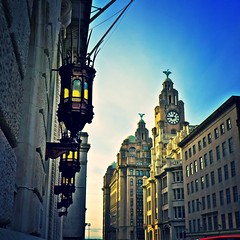 The Royal Liver Building...and some ornate street lamps. (MickyFlick) Tags: uk england liverpool europe waterfront unitedkingdom architectural panasonic threegraces historical waterstreet pierhead liverbirds royalliverbuilding 3graces mickyflick dmclx7