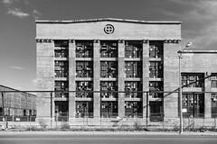 (el zopilote) Tags: albuquerque newmexico street architecture cityscape industrail signs powerlines clouds graffiti canon eos santaferailwayshops santaferailroad 1dsmarkiii canonef24105mmf4lisusm fullframe bw bn nb blancoynegro blackandwhite noiretblanc schwarzweiss monochrome