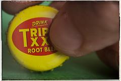 Double XX (hbmike2000) Tags: macro closeup typography nikon drink finger nail thumb soda d200 hmm bottlecap rootbeer seeingdouble hoya closeuplens macromonday triplexxxrootbeer hbmike2000