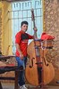 Jazz musician in Trinidad bar, Cuba (sophie_merlo) Tags: street streetphotography candid people doublebass music musician jazz trinidad cuba caribbean parking