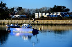 When the Tide goes Out (hapsnaps) Tags: hapsnaps 2017 winter hampshire penningtonmarshes keyhaven unusualangle leaning boats fishingboats water sea quayside quay reflections blue