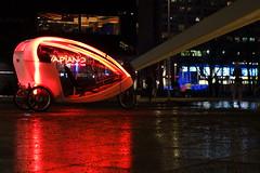 Fahrradrikscha unterm Fernsehturm (Pascal Volk) Tags: berlin mitte alexanderplatz fernsehturm televisiontower tvtower berlinmitte nacht night nass wet spiegelung reflection reflexion fahrradtaxi fahrradrikscha cyclerickshaw pedicab velotaxi bicitaxi tricitaxi sonydscrx100 rot red illuminated beleuchtet vapiano