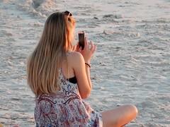 Back to the Phone (mikecogh) Tags: glenelg sunset beach woman crosslegged sand phone