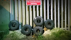 No Authorised Parking (WatermelonHenry) Tags: tyres wheel rubber fence metalbars donotenter noparking donotpark blackpool allyway backstreet rubbish sign parking grass grassverge cartyres
