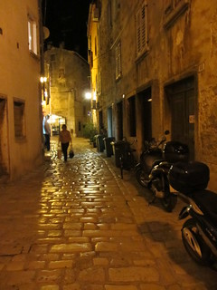 Street with parked motorcycles, night in Rovinj, Croatia