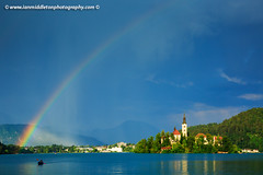 Rainbow over Lake Bled (Ian Middleton: Photography) Tags: travel summer vacation mist lake holiday storm mountains reflection building green tower history tourism church water beautiful architecture clouds religious island rainbow scenery europe european bell famous scenic eu tourist architectural historic christian slovenia alpine touristy stunning bled former christianity popular yugoslavia attraction shimmering eec slovenian slovene gorenjska slavic