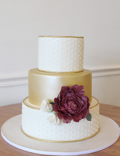 Swiss Dots and Metallic Gold Wedding Cake with Burgundy Flower