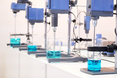 Dynamic Blending Specialists (dynamicblending) Tags: blue industry toxic water glass bottle lab technology acid tube experiment science biotech drop equipment medical fluid study health research chemistry laboratory instrument drug sample medicine cosmetics discovery biology liquid virus development microbiology tool beaker scientist biotechnology chemical medication reagents analysis scientific glassware substance pharmaceutical