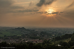 Hazy Glastonbury Sunset (hillandsky) Tags: glastonbury glastonburytor tor glasto nationaltrust somerset sunset cloudy hazy sun sunray sunrays sunlight sunbeam sunbeams hdr hdrlandscapes hdrsunset