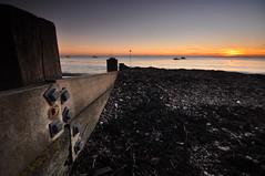 Essex Thorpe Bay (daveknight1946) Tags: watrescape beach shingle breakwater sunset boats essex thorpebay orange bolts