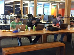Socializing and Hackathoners perfecting their app!