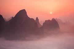 Foggy Sunrise (malaholic) Tags: china mist mountains fog sunrise haze yangshuo hills layers peaks karst guangxi valleyfog
