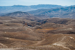 Desert with Mar Saba monastery in a distance (Lena and Igor) Tags: road travel blue panorama brown mountains west landscape israel nikon asia desert zoom palestine westbank scenic middleeast bank monastery telephoto 1855 nikkor dslr distance d40 marsaba