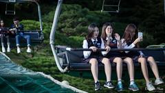 Mixed feelings (gunman47) Tags: 2016 asia asian everland korea korean october rok republic seoul south suwon yongin distractions exhibit female girl modern park photography resting ride student theme tired