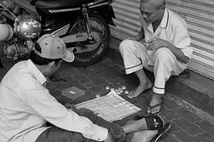 The game (gambajo) Tags: vietnam hanoi travel men game playing blackandwhite blackwhite street streetphotography
