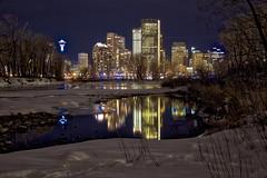 Calgary Night Glow (John Andersen (JPAndersen images)) Tags: 2017 bluehour bowriver calgary city cold ice january reflections skyline snow towers winter