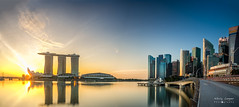 Sunrise at the Bay (NikolajAlexanderPics) Tags: tamron2470 24mm tamron ilce7m2 a7 a7ii sony asia blue bridge cityscape colorful highrise longexposure marinabay marinabaysands reflections river singapore sky skyline sunrise water city