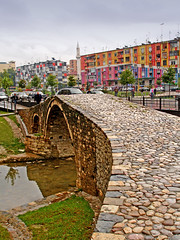 Old bridge in Tirana, Albania (net_efekt) Tags: old city travel bridge houses color colour cars stone river stream europe view stones capital mosque cobble bach pebble highrise pont colourful albania brcke farbig bridging tirana shqipris shqipria hochbau abouttiranaalbania