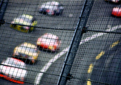 So Close, Yet ... (beebo wallace) Tags: film 35mm fence published bokeh nascar autoracing charlottenc nowpublic motorsport lowesmotorspeedway