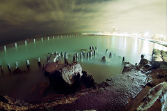 Blown Out Lakefront (candersonclick) Tags: longexposure chicago green wet water skyline rocks nuclear fisheye shiney lakefront