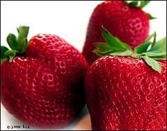 Srawberry Up Close (ranhar2) Tags: red white detail macro green closeup fruit strawberry close artistic seeds fruity