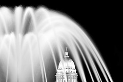 Capitol Fountain at Monona Terrace (Todd Klassy) Tags: longexposure light sky blackandwhite white abstract black color building art history water fountain beautiful horizontal wisconsin architecture night composition dark outdoors evening democracy election midwest day mood shadows exterior unitedstates state flash fineart capital landmark franklloydwright business capitol madison dome granite government pillars wi legislature abundance pediment senate timeelapsed assembly prosperity urbanlandscape statehouse capitolbuilding mononaterrace stockphotography winterscene calendarphoto royaltyfree isthmus urbanscene flowingwater colorimage wisconsinstatecapitol 53702 governorsoffice statecapitolbuilding danecounty wisconsincaptiol wisconsinsupremecourt wisconsinscene biggovernment stateofwisconsin officeofthegovernor wisconsinstatelegislature