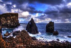 Rocks and vivid sky  ... (asmundur) Tags: ocean coast iceland rocks flickr surf cloudy vivid hdr reykjanes outing phototrip photomatix april2006 3exposures
