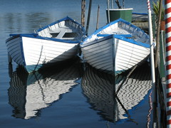 The Gondolas of Oakland (JakeEssl) Tags: california blue white lake reflection freeassociation tag3 taggedout reflections boats oakland boat tag2 tag1 lakemerritt gondola merritt 1on1 anchored purge interestingness418 purge17 thecontinum jakeessl peak418