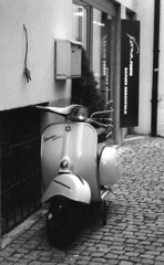 Vespa, Baden-Baden Germany (Laura Dunn-Mark) Tags: road street travel blackandwhite bw alps brick 2004 germany alley europe vespa scooter adventure lane transportation parked badenbaden baden lauradunnmark