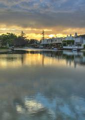 Sunset beckons the storm (KaroliK) Tags: sunset lake storm reflection clouds camarillo interestingness3
