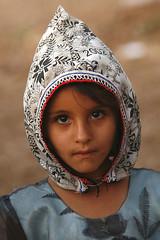 Young girl with wearing a hood - Yemen (Eric Lafforgue) Tags: woman girl female republic femme arabic arabia yemen arabian ramadan fille yemeni yaman arabie jemen lafforgue arabiafelix  arabieheureuse  arabianpeninsula ericlafforgue iemen lafforguemaccom mytripsmypics imen imen yemni    jemenas    wwwericlafforguecom  alyaman ericlafforguecomericlafforgue contactlafforguemaccom yemenpicture yemenpictures