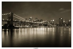 Downtown Lights (Arnold Pouteau's) Tags: nyc newyorkcity bridge bw newyork reflection sepia brooklyn night downtown manhattan f50