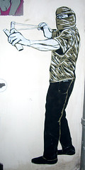 slinger terrorist (Smeerch) Tags: mostra italy streetart stencils rome roma art poster graffiti stencil sticker italia arte expo stickers terrorist spray exposition sling posters terrorism sanlorenzo graffito sten adhesive lex aerosolart spraycan esc lazio woostercollective esposizione terrorismo terrorista adesivo adesivi kefiah artedistrada internationalposterart lucamaleonte adhesives kefia viadeireti fionda fiondare