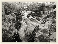 Untitled (Jonas Thomn) Tags: sea bw white black beach wet water sepia night finland rocks stones wave splash pietarsaari jakobstad sterbotten ostrobothnia fboda
