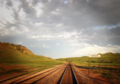 in fair verona, where we lay our scene (reposted - see description) (manyfires) Tags: rural train landscape evening countryside traintracks tracks verona wyoming