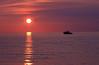 Great Island Sunset (richietown) Tags: ocean sunset sun topf25 topv111 clouds bay boat interestingness topv555 topv333 raw capecod massachusetts stock topv999 explore getty topv777 28135mm wellfleet greatisland scoreme41 outstandingshots specnature richietown