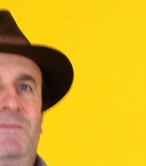 Gelb (Nicote) Tags: portrait man black blur eye film face hat yellow proud greek nose noir background lips marlowe cropped philip detective 50ees criminalstory