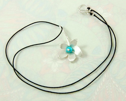 shaped flower pendant with turquoise bead