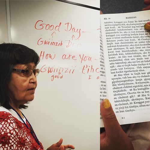 Ruth Carroll teaches basic #gwichin phrases at #yxy #yukon Kwanlin Dün Cultural Centre, #whitehorse. The photo on the right shows a bible in old-style Gwichin. The first writing system for the #language was created by Robert McDonald, a Church of England