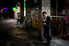 property agent (Rob-Shanghai) Tags: people agent property street smoking mobile night shanghai china 35mm leica m240