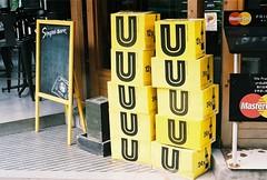 UUUUU (35mm) (jcbkk1956) Tags: boxes u bangkok thailand thonglo bar restaurant minolta xd7 manualfocus 35mm 50mmf17 fujicolour200 drinks yellow stacked worldtrekker