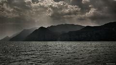 Thick air on the lake - Una giornata umida al lago (Marchindeed) Tags: lake hot water clouds lago garda air sunbeam humid